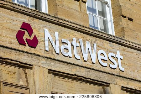 Dorchester, Uk - August 15th 2017: The Logo Above The Entrance To A Natwest Bank Branch In Dorcheste