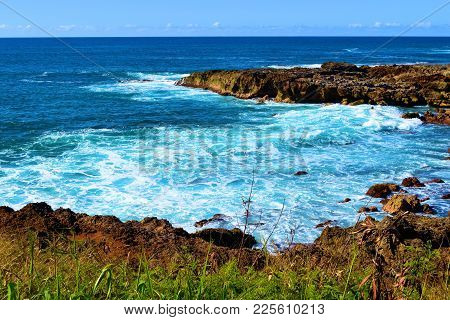 Waves Crashing Onto Volcanic Lava Rocks Taken On A Rural Rugged Beach At The North Shore In Oahu Haw