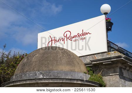Bournemouth, Uk - August 17th 2017: The Sign Above The Entrance To A Harry Ramsden Fish And Chips Re