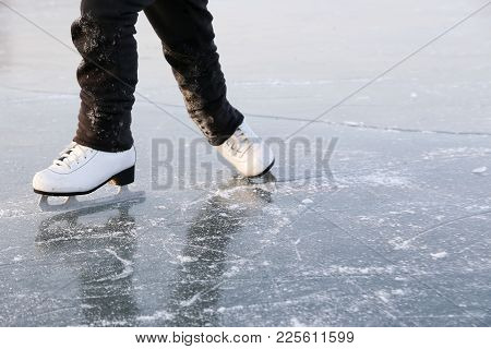 Young Woman Ice Skating Outdoors