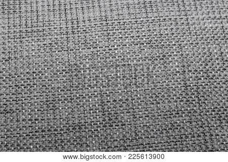 Texture by discoloured gray woven fabric, with lights.