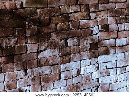 Discoloured brickworks made of criss-cross put bricks, with light-ray.