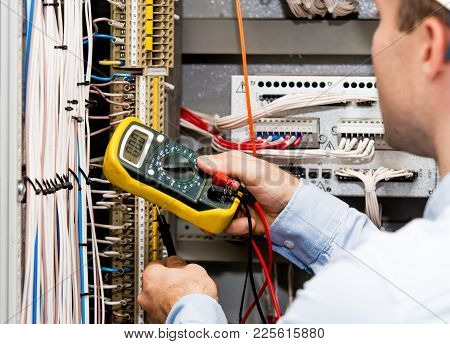 Engineer Checking Power Supply With Multimeter. Zero Value Of Voltage On Multimeter.