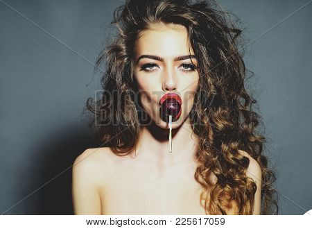 Sexy Woman With Lollipop In Sensual Mouth. Girl Beauty, Makeup, Look, Hair, Hairstyle. Blowjob, Hand