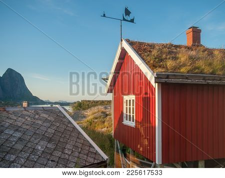 Typical Rorbu Cottages In Reine. These Traditional Seasonal Cottages Used By Fishermen In Lofoten Ha