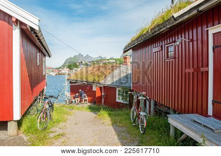 Reine, Norway - July 4, 2011: Typical Rorbu Cottages In Reine. These Traditional Seasonal Cottages U