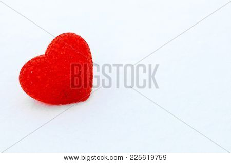 Red Textured Heart Lies On The Snow