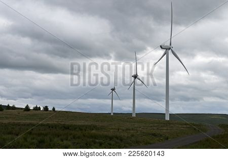 3 Wind Turbines Standing In The Countryside Of Donegal.