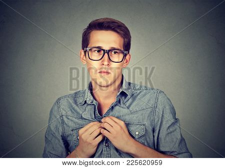 Nervous Introvert Man Feels Awkward Looking Anxiously Away Isolated Gray Wall Background.