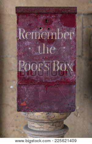 A Remember The Poors Box Located At St. Bartholomews Hospital In London, Uk.  Before The National He