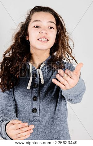 Teen act a scene and wearing a blue sweatshirt while posing