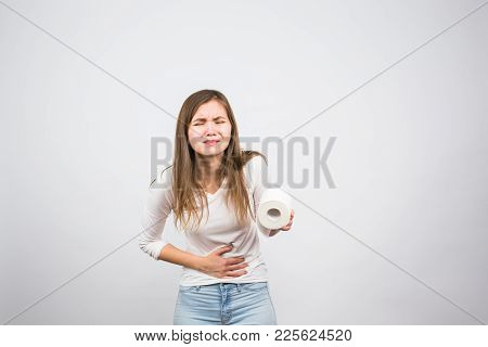 Sick Woman With Hands Pressing Her Crotch Lower Abdomen, Holding Paper Roll. Medical Problems, Incon
