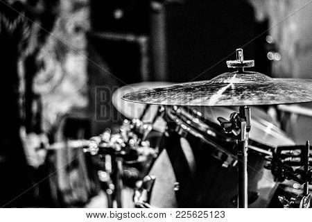 Drum set close-up Drummer equipment Cymbal of the drum set Black and white stylish photo for posters and banners