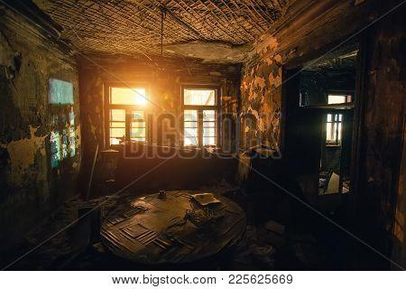 Dark And Creepy Interior Of Abandoned Burned House.