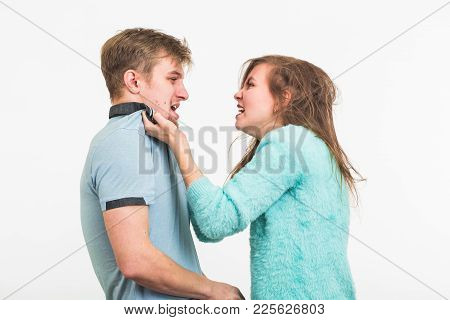 Domestic Violence, Abuse And People Concept - Man Beating Woman.