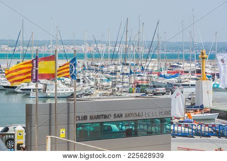 Mallorca, Spain - July 22, 2013: Marina With Masts, Parked Cars And People On A Sunny Day On July 22