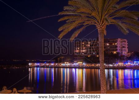 Mallorca, Spain - July 24, 2013: Night Scene With Neon Light Reflections From The Pier Restaurants I