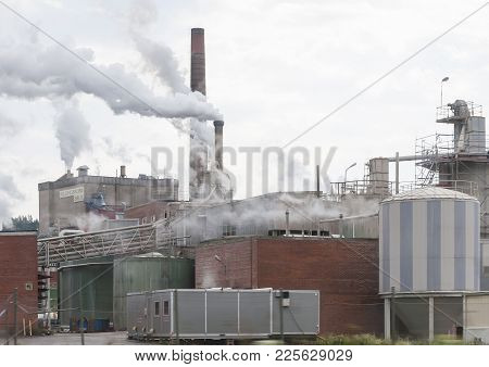 Billingsfors, Dalsland, Sweden On July 1, 2012: Industrial Chimneys With Fumes And Smoke At Billings