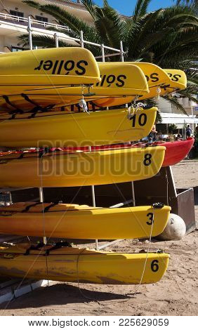 Port De Soller, Mallorca, Spain On October 25, 2013: Yellow Canoes Stacked On A Sunny Day On October