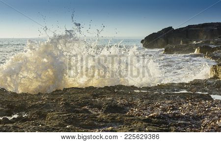 Breaking Wave Closeup In Ses Covetes, Mallorca, Balearic Islands, Spain In October.