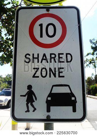 10km Per Hour In A Shared Zone Sign