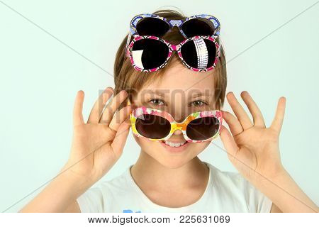 Close-up Portrait Of A Little Girl Wearing Funky Sunglasses. Young Teenage Girl Wearing Stylish Sung