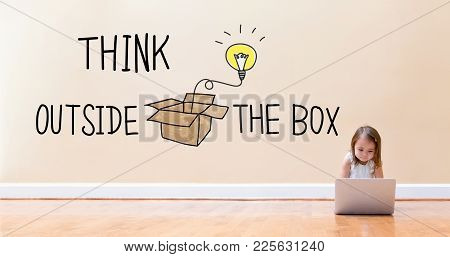 Think Outside The Box Text With Little Girl Using A Laptop Computer On Floor