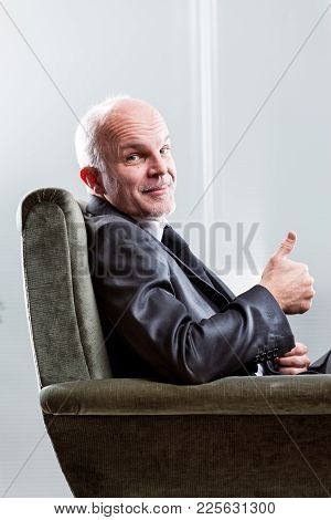 Satisfied Happy Businessman Giving A Thumbs Up
