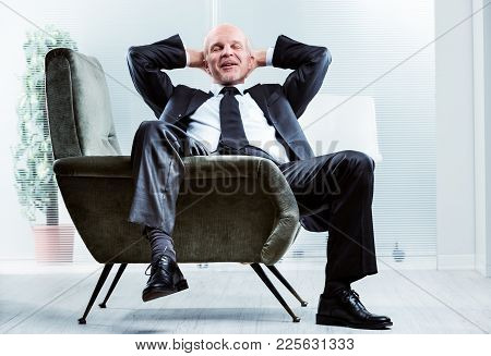 Businessman Sitting Relaxing And De-stressing