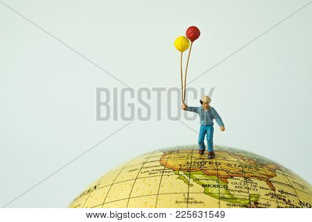 Miniature People Figure Happy Man Holding Balloons Standing On United States Of America Map On Globe