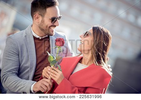 Young Couple With Rose Outdoors