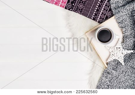 Mug With Coffee And Home Decor On White, Cosy Wooden Table Background. Winter Morning Relax Concept,