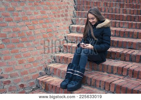 Teenage Girl Using Smartphone Outside Smiling Texting Massage Connecting Networking Surfing Net Soci
