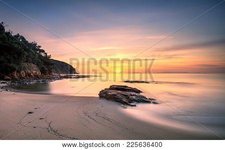 Sunset In Cala Violina Bay Beach In Maremma, Tuscany. Travel Destination In Mediterranean Sea. Italy