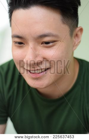 A Young Handsome Asian Chinese Man Smiling Happily