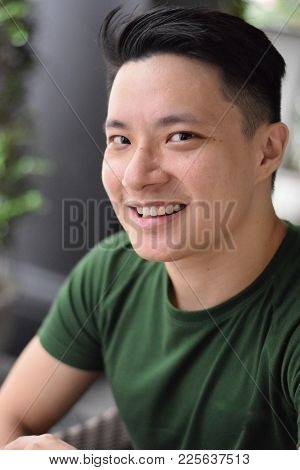 A Young Asian Handsome Man Smiling Happily