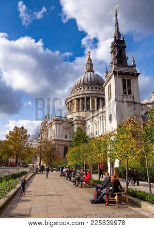LONDON, UK - OCTOBER 30, 2012: Londoners enjoying sunny autumn day at the St Paul's Cathedral, one of the most famous and recognisable sights of London