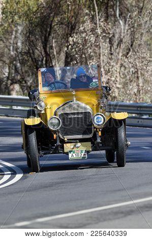 Adelaide, Australia - September 25, 2016: Vintage 1913 Wolseley 16/20 Roadster Driving On Country Ro