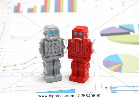 Robots or artificial intelligence and graphs are written documents on white background. Concept of a