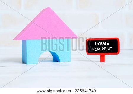 Selective Focus Of Red Blackboard Written With House For Rent With House Model On White Wooden Backg