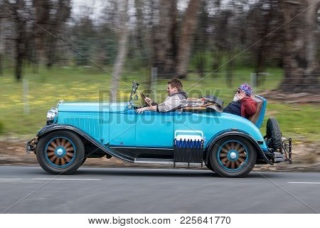 Adelaide, Australia - September 25, 2016: Vintage 1929 Plymouth Roadster Driving On Country Roads Ne