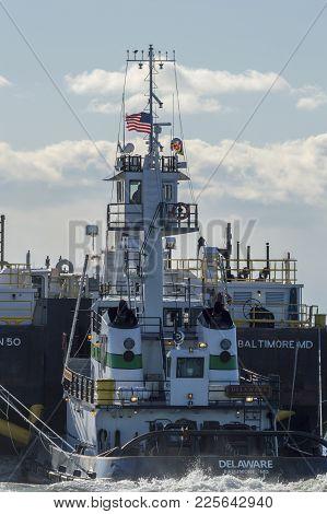 New Bedford, Massachusetts, Usa - February 3, 2018: Pusher Tug Delaware Guides Barge Double Skin 50