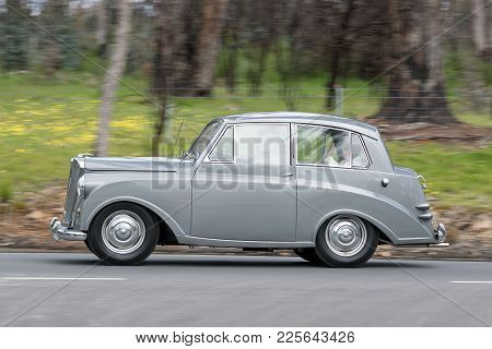 Adelaide, Australia - September 25, 2016: Vintage 1952 Triumph Mayflower Saloon Driving On Country R