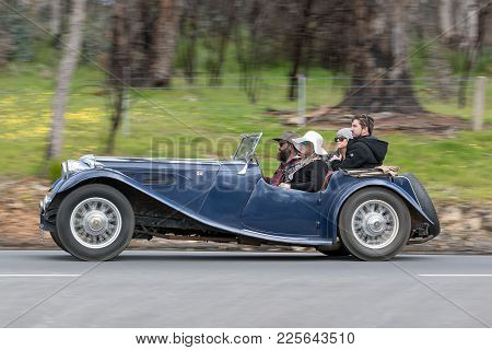 Adelaide, Australia - September 25, 2016: Vintage 1940 Jaguar Ss Drophead Coupe Driving On Country R