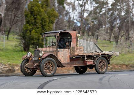 Adelaide, Australia - September 25, 2016: Vintage 1927 Chevrolet Utility Truck Driving On Country Ro