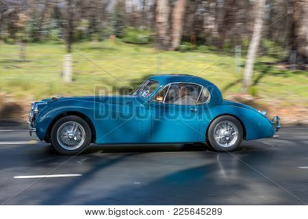 Adelaide, Australia - September 25, 2016: Vintage 1953 Jaguar Xk 120 Coupe Driving On Country Roads