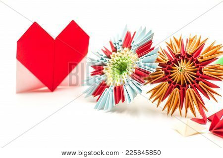 Valentine Day Concept. Module Origami Paper Flowers Craft And Red Valentine Heart Isolated On White