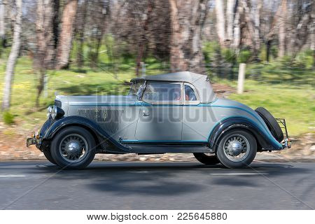 Adelaide, Australia - September 25, 2016: Vintage 1934 Plymouth Pf Roadster Driving On Country Roads