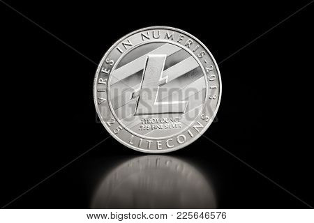 The silver litecoin. Altcoin on black table.