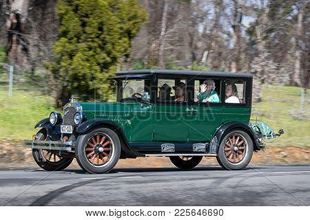 Adelaide, Australia - September 25, 2016: Vintage 1926 Oldsmobile E Series Sedan Driving On Country